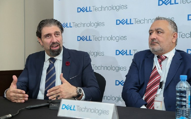 Nazih Moufarrej, Dell EMC Regional Senior Director (right) and Ken Kagota, Clients Solutions Specialist, Dell Kenya showcase various Dell products to Jerome Ochieng, Principal Secretary, Ministry of ICT during the Dell technologies regional conference held at Kempinski Hotel Nairobi.