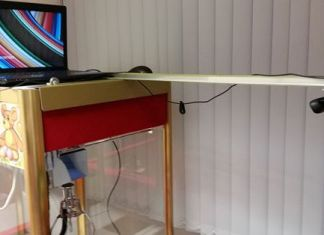 This crane machine is hooked up to a Raspberry Pi so you can play it from home