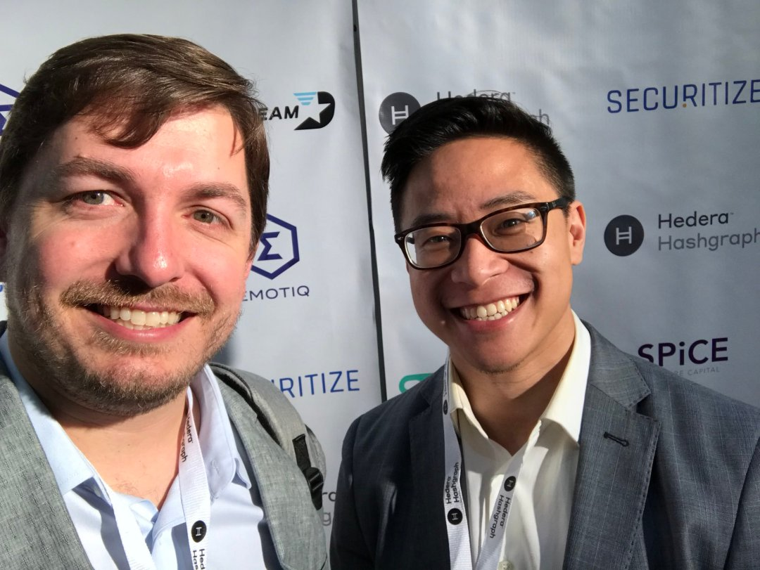 Sagewise team posing before a Crypto Invest Summit logo wall
