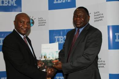 Tony Mwai IBM CGM and Dr. Bitange Ndemo PS ministry Of information presenting the white paper at the event.