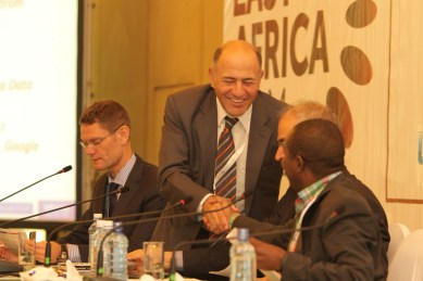 Telkom Kenya CEO Mickael Ghossein shakes hands with Google Kenya country manager Joseph Mucheru