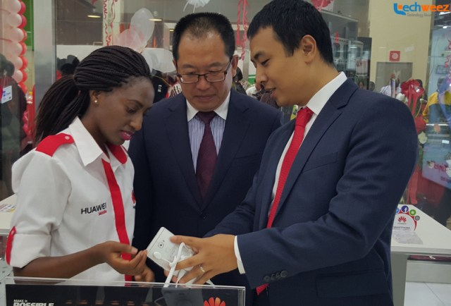 Huawei Kenya CEO Dean Yu and the Chinese Embassy Consular are take a look at the Huawei Mate S shortly after opening the Huawei brand store at Garden City Mall, Nairobi