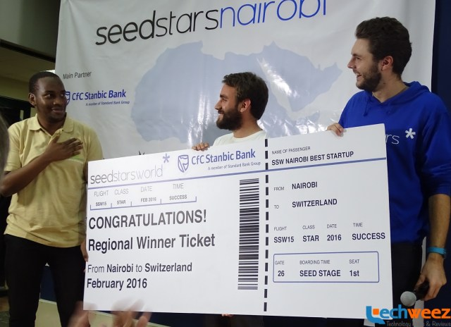 Taita Ngetich (left) being handed his ticket to Switzerland by Regional Managers for Africa, Seedstar World, Marcello Schermer and Gregory Pepper (right)