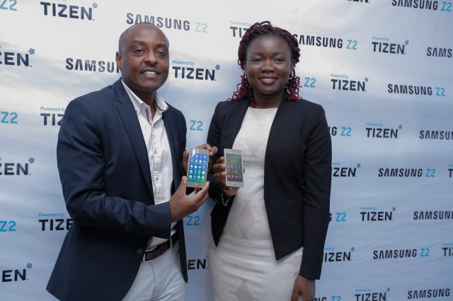 Samsung Electronics East Africa Mobile and IT Head Simon Kariithi and Product Manager Idda Rasanga pose with the device during the launch at Samsung's Nairobi offices