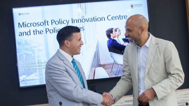Microsoft Middle East and Africa Director for Government and Regulatory Affairs Christopher Akiwumi (R) and Strathmore Law School Dean Dr Luis Franceschi