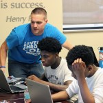 TechWise Academy Instructor Assists Teen in Unity Class