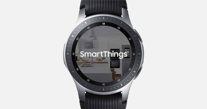 Screenshot of the Galaxy Watch with Smart things showing the App logo and a background of a home