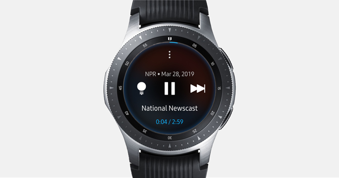 Screenshot of the Galaxy Watch with the NPR interface of the player showing pause button and general info.