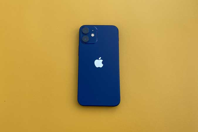 iPhone 12 mini on Yellow background