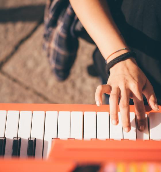 Young beautiful caucasian girl playing piano