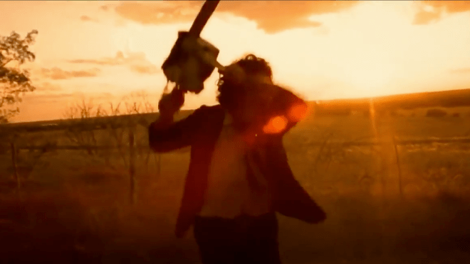 Leatherface swinging his chainsaw during the sunset.