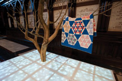 "Sanford Biggers, ""Constellation,"" 2009, Steel, Plexiglas, LED\u@019s, Zoopoxy, cotton quilt, original printed cotton tile. Dimensions variable, Installation at Harvard University. Courtesy the Artist and Michael Klein Arts, New York, N.Y."