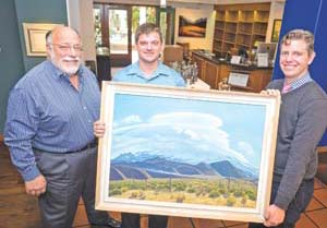 From left, Frank Goss, Nathan Vonk and Jeremy Tessmer are producing a book about artist Ray Strong. NIK BLASKOVICH/NEWS-PRESS PHOTOS