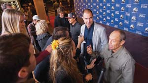 From left, director Justin McMillan, big-wave surfer Ross Clarke-Jones, director Chris Neilus and world surfing champion Tom Carroll take questions from reporters at the event.
