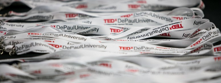 """Lanyards are among the gifts offered to attendees of TEDxDePaulUniversity Tuesday, April 18, 2017, in the Lincoln Park Student Center. TEDxDePaulUniversity is an independently run, self-organized event. Through the theme """"Courage to Connect"""" 10 speakers from across the DePaul community challenged thoughts and inspired ideas through a series of engaging talks and presentations. (DePaul University/Jeff Carrion)"""