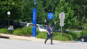 An American University staffer walks by an emergency tower on campus.