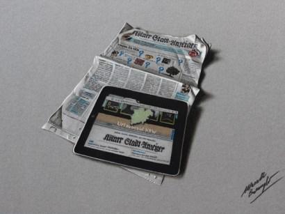 Ipad върху вестник