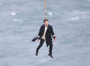 EXCLUSIVE: **NO UK** **PREMIUM EXCLUSIVE RATES APPLY** Floppy haired heartthrob Harry Styles is winched from a helicopter above remote farmland shoreline in a secret location in Scotland earlier this week filming his debut music video Sign of the Times. And these incredible pictures show the 23-year-old intends to make his entrance in the most dramatic of fashions. The One Direction heartthrob announced just last weekend that his debut solo single 'Sign of the Times' will be released this Friday. Pictured: Harry Styles Ref: SPL1473683 050417 EXCLUSIVE Picture by: FameFlynet / Splash News Splash News and Pictures Los Angeles: 310-821-2666 New York: 212-619-2666 London: 870-934-2666 photodesk@splashnews.com