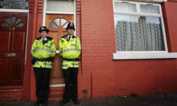 police-outside-a-house-in-manchester-following-arrest-of-10-pakistanis