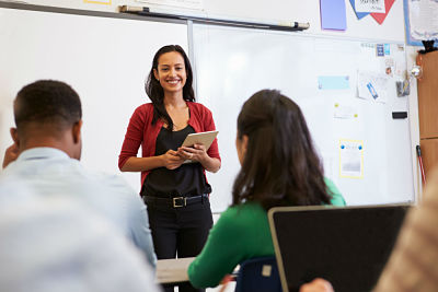 Woman TEFL teaching young adults English