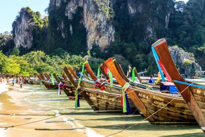 Thai wooden boats on the beach in Krabi