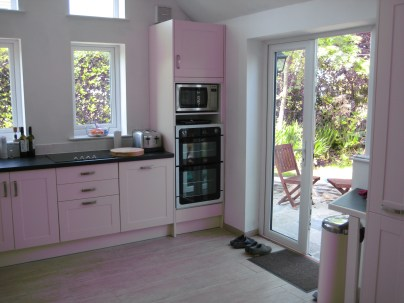 View of the kitchen with double doors out to a patio area