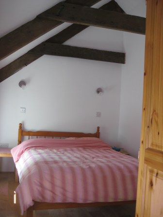 Upstairs bedroom with a double bed