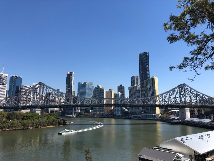 Brisbane skyline with a ferry on the river
