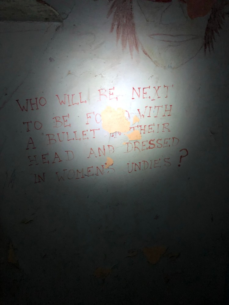 Writing on wall in prison cell