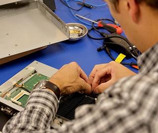 Teguar service technician fixing an industrial computer