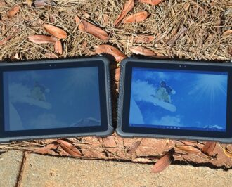Two Teguar rugged tablets side by side outside showing high brightness model on the right