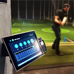 Touchscreen tablet used at a golf driving range