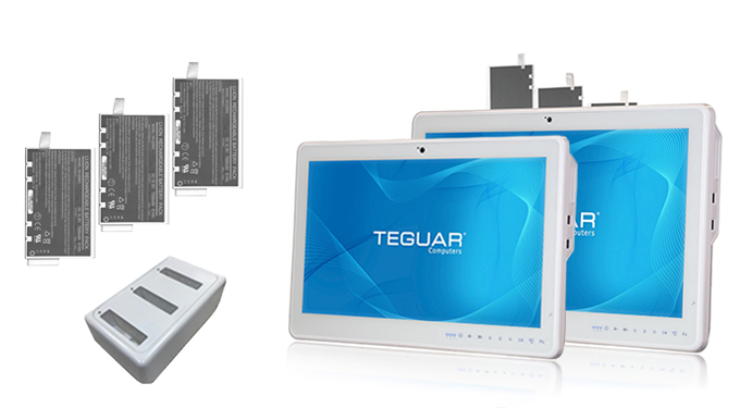 Two Teguar medical cart computers and three hot swappable batteries