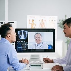 Health professionals use a medical computer for telehealth video conferencing