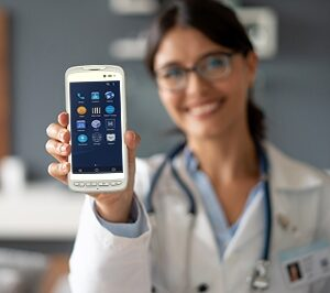 Healthcare professional holds up a medical rugged handheld smart device