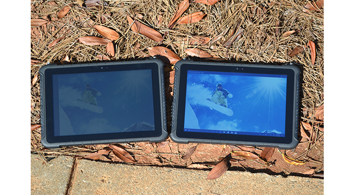 Two TRT-4380 rugged tablets outside on the ground, one with low brightness and one with high brightness