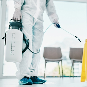 Agent in protective coating sprays down a clean room