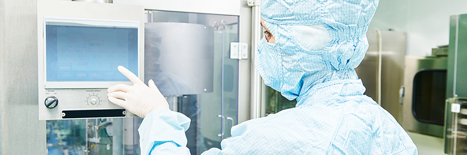 Person using a touchscreen computer in a clean room