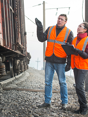 Two logistics coordinators using a rugged tablet to work