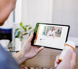 Patient meets with their doctor in telehealth visit