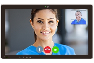 A medical professional holding a telehealth appointment with a patient on a tablet device