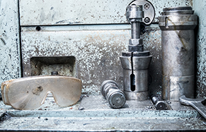 Industrial scene with pipes and safety goggles
