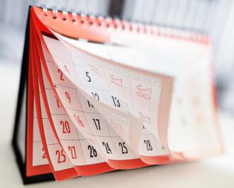 A desk calendar flipping though the months
