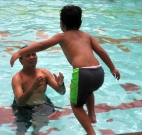 father, waiting for his son jumped into the pool