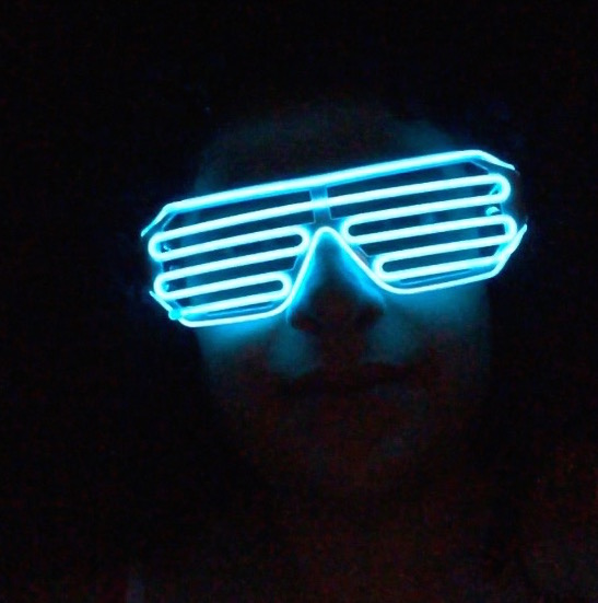 Digital photograph of me wearing neon glasses.