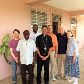 Tek4Kids volunteers and Bishop Decoste
