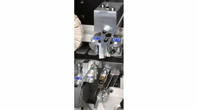 Автоматический кромкооблицовочный станок Minimax ME 40 TR, производство SCM Италия, группа скребков для клея