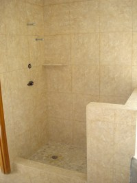 Shower with 1818 in porcelain tile with river rock shower ...