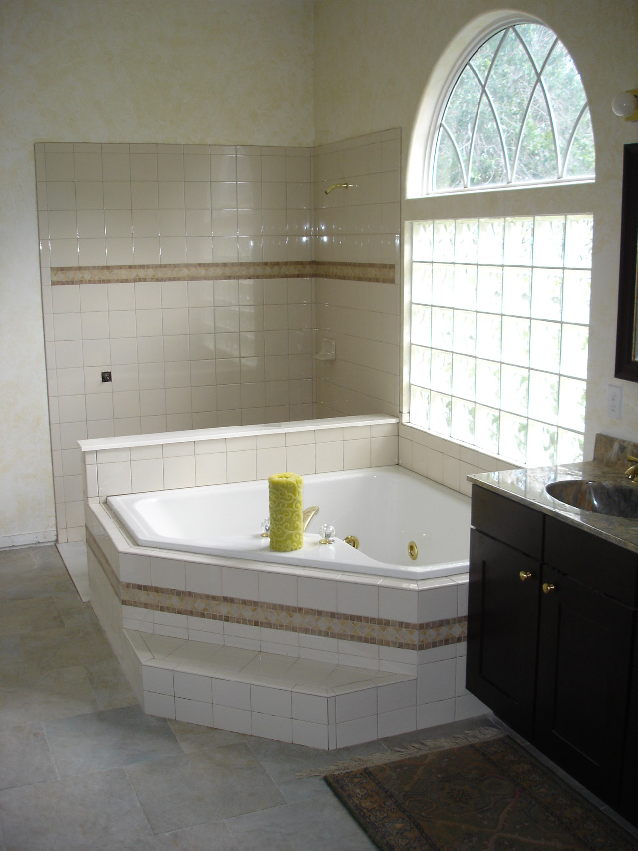 Shower and garden tub with almond 66 ceramic tile  Tek