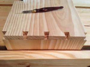 Transferring the dovetail layout to the pin board.
